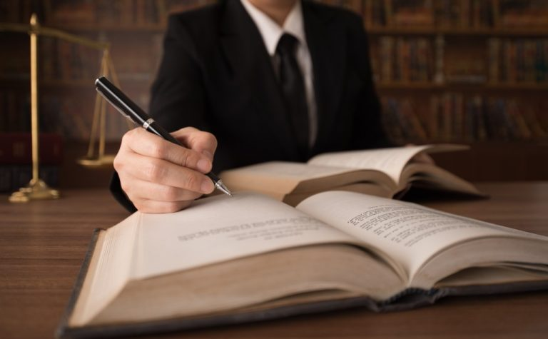 Lawyer writing on a book