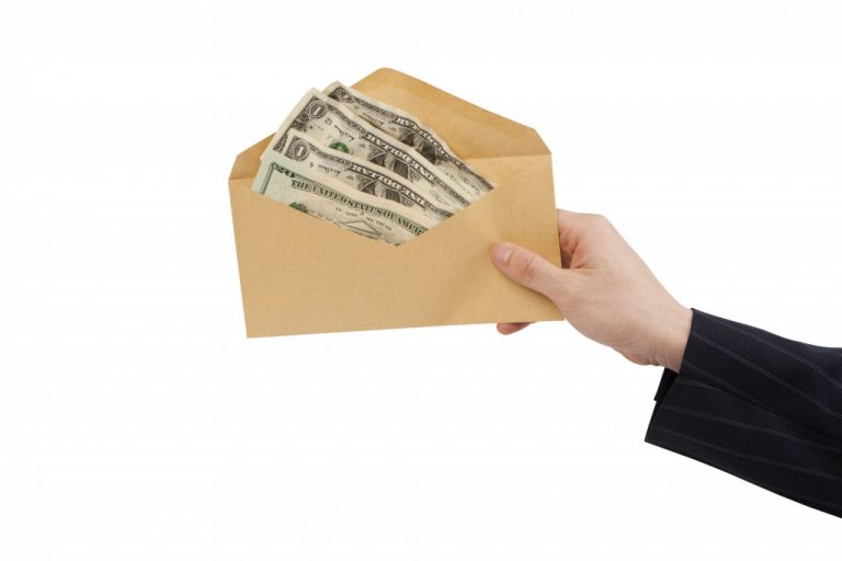 holding an envelope with money