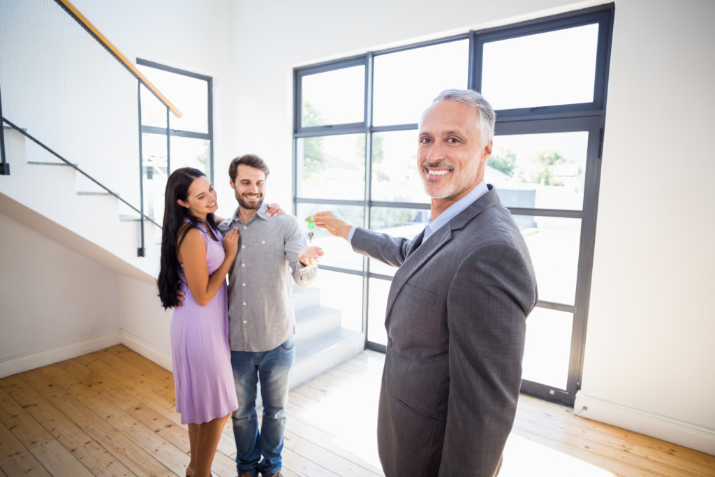 man selling house to couple